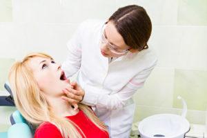 Какое лечение выбрать, если шатается зуб